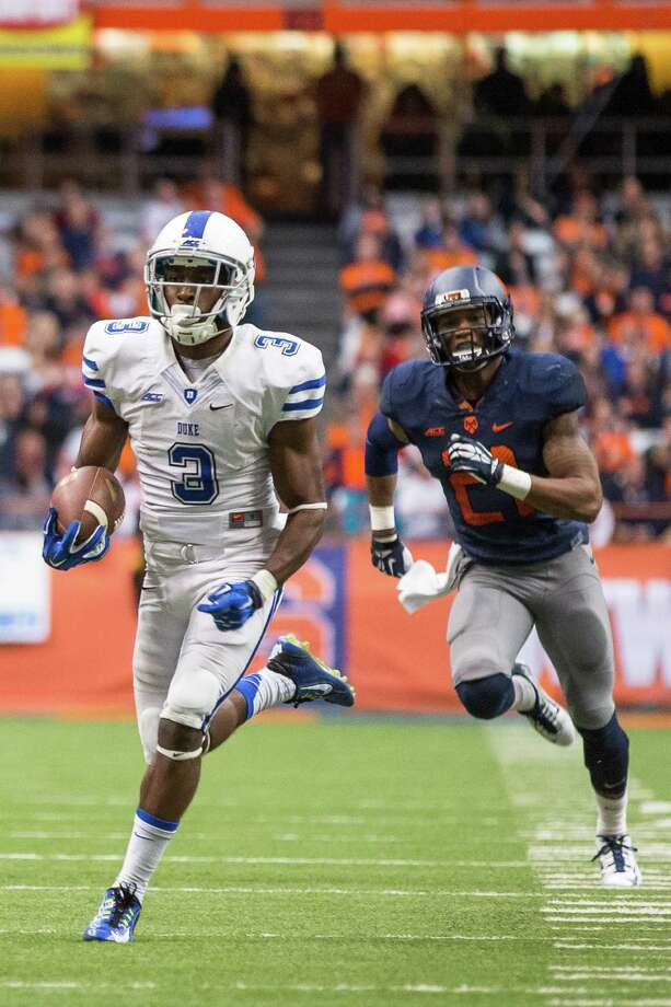 SYRACUSE, NY - NOVEMBER 08:  Jamison Crowder #3 of the Duke Blue Devils runs back a punt for a touchdown against the Syracuse Orange on November 8, 2014 at The Carrier Dome in Syracuse, New York.  Duke defeats Syracuse 27-10.  (Photo by Brett Carlsen/Getty Images) ORG XMIT: 520983139 Photo: Brett Carlsen / 2014 Getty Images