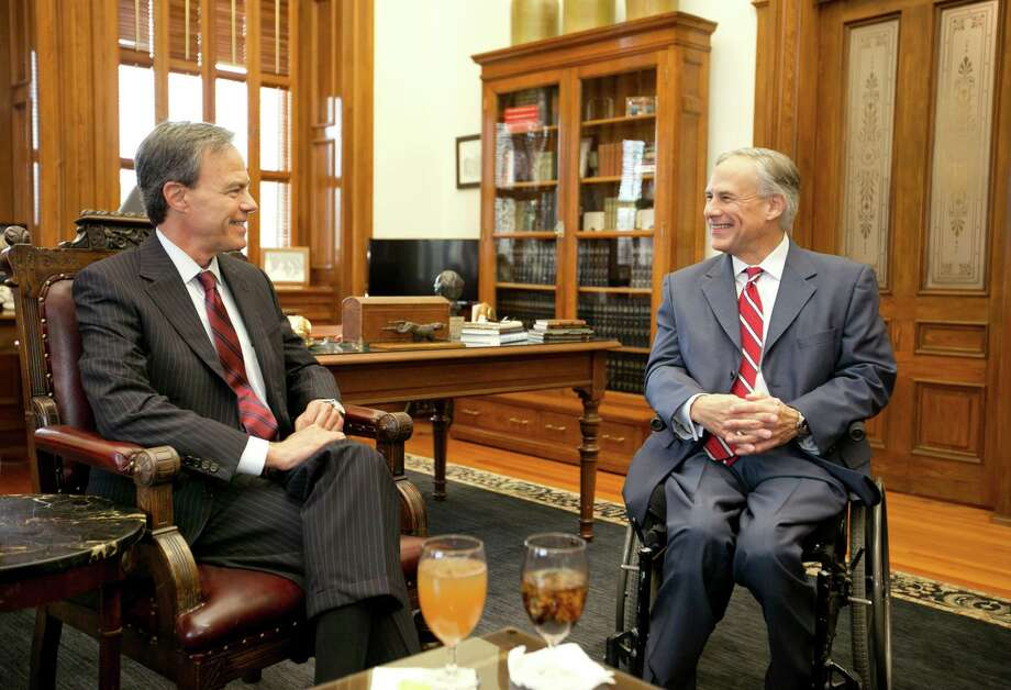 Gov.-elect Greg Abbott, right, meets with Speaker of the House Joe Straus on Wednesday in the Capitol. Abbott and Straus have similar personalities and management styles, political insiders say, but on policy Abbott and Lt. Gov.-elect Dan Patrick may be closer alike. Photo: Jay Janner, MBO / Austin American-Statesman