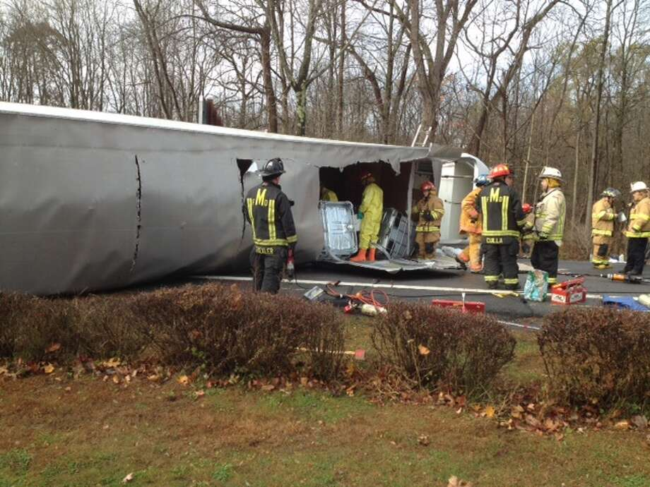 Emergency officials work at the scene of a truck rollover in Clifton Park on Friday. (State Police photo)