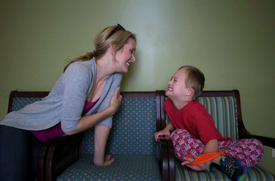 Seth Skaggs, 6, shows off his clean teeth to his mother, Emily Skaggs, after his first full oral health evaluation on Oct. 28. Photo: Marie D. De Jesus, Staff / © 2014 Houston Chronicle
