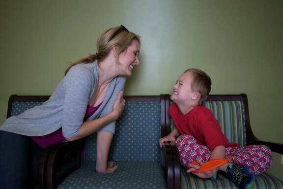 Seth Skaggs, 6, shows off his clean teeth to his mother, Emily Skaggs, after his first full oral health evaluation on Oct. 28.