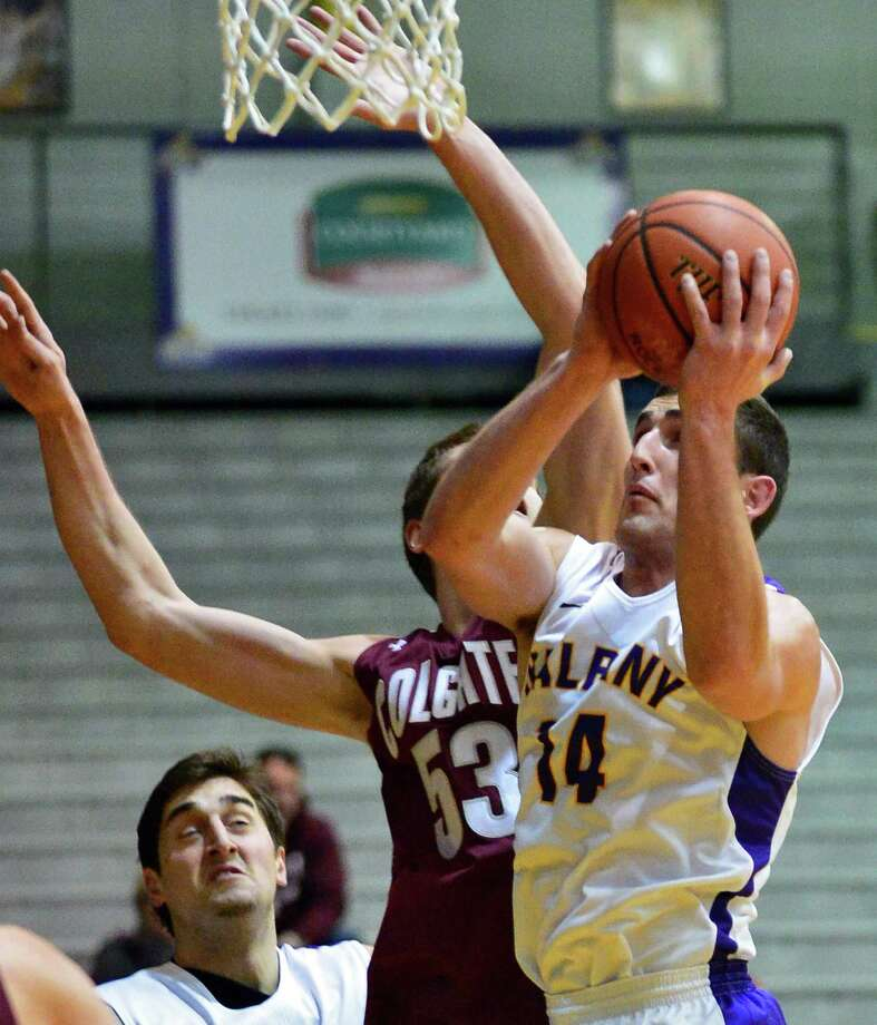 Albany 's #14 Sam Rowley during Saturday's game against Colgate at the SEFCU Arena Dec. 14, 2013, in Albany, NY.  (John Carl D'Annibale / Times Union) Photo: John Carl D'Annibale / 00024942A
