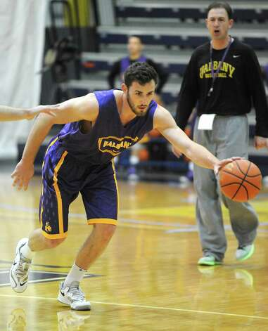 Sam Rowley dribbles the ball down the court during the first basketball practice of the season for the UAlbany men on Thursday, Oct. 9, 2014 in Albany, N.Y. (Lori Van Buren / Times Union) Photo: Lori Van Buren / 10028939A