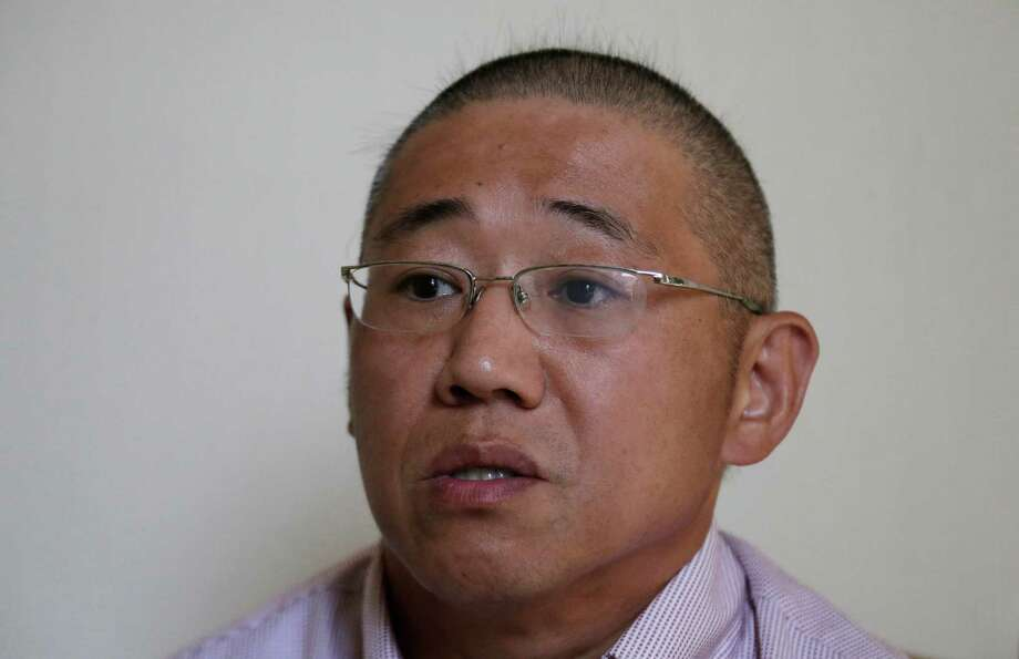 FILE - In this Sept. 1, 2014 file photo, Kenneth Bae speaks to the Associated Press in Pyongyang, North Korea. The US announces Saturday the release of Americans Bae and and Matthew Todd Miller who were detained in North Korea, saying they're on way home. (AP Photo/Wong Maye-E, File) Photo: Wong Maye-E, STF / AP