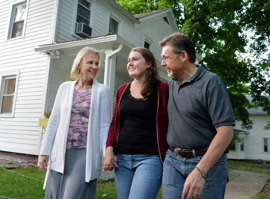 Skidmore freshman Olivia Cox, center, with her parents Ruth and Jeff Cox outside their home Saturday Sept. 20, 2014, in Niskayuna, NY. The family traveled to Peru so that Olivia and her father could undergo stem cell therapy to treat their diabetes.  (John Carl D'Annibale / Times Union) Photo: John Carl D'Annibale / 00028677A