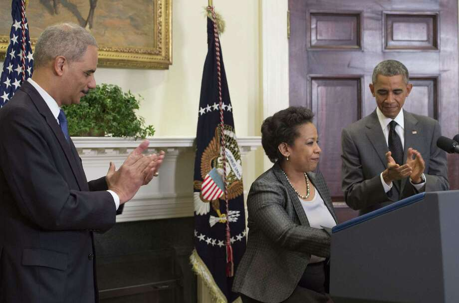 At a White House news conference on Saturday, President Barack Obama announced that Loretta Lynch is his choice to replace Attorney General Eric Holder, left. Lynch has been praised for her low-key approach to prosecutions and has been approved by the Senate twice before for federal positions. Photo: JIM WATSON, Staff / AFP ImageForum