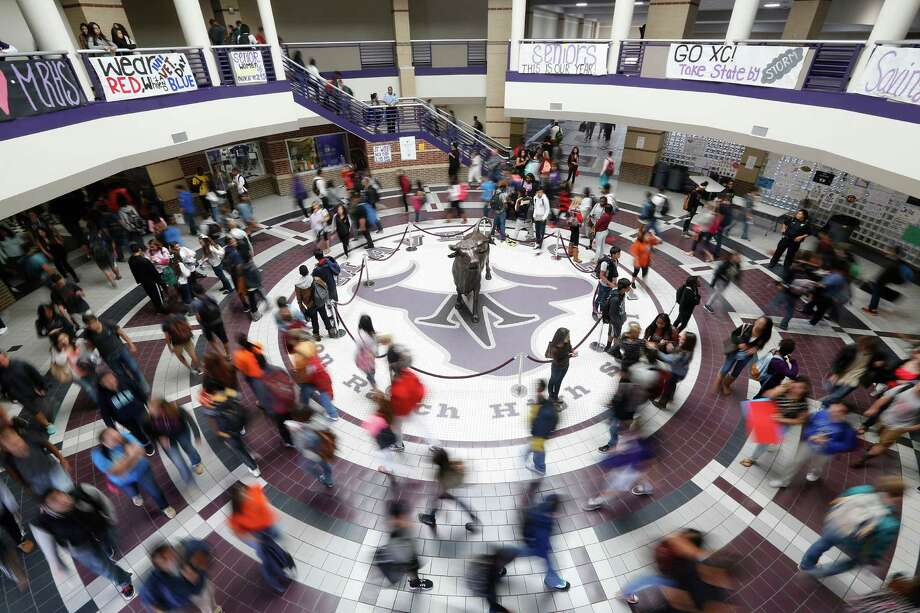 Students make their way to class Friday at Morton Ranch High School in Katy. The school currently has about 3,400 students, which is 400 over its ideal maximum. A recent bond passed in the Katy Independent School District will allow the building of a new high school to accommodate recent growth in the area. Photo: Johnny Hanson, Staff / © 2014  Houston Chronicle