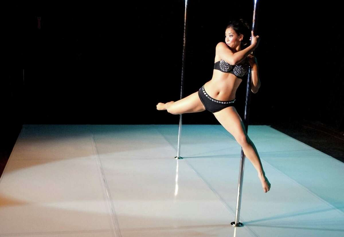 Julia Ly dances on the pole during her performance at the Melee on the Bayou pole dancing competition at Grooves of Houston in downtown Houston, Texas on Saturday, Nov. 8, 2014.