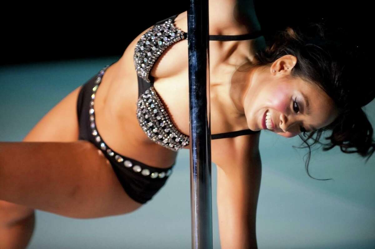 The Melee on the Bayou pole dancing competition was held at Grooves of Houston in downtown Houstonon Saturday, Nov. 8, 2014.Julia Lydances on the pole during her performance.