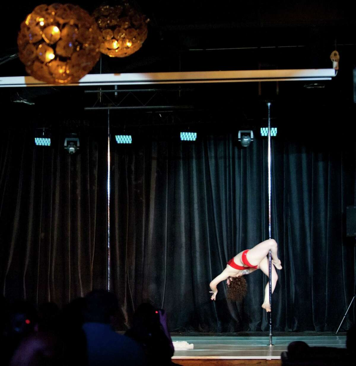 Jillian Boecker, also known as âÄúNotorious Sinner,âÄù dances on the pole at the Melee on the Bayou pole dancing competition at Grooves of Houston in downtown Houston, Texas on Saturday, Nov. 8, 2014.