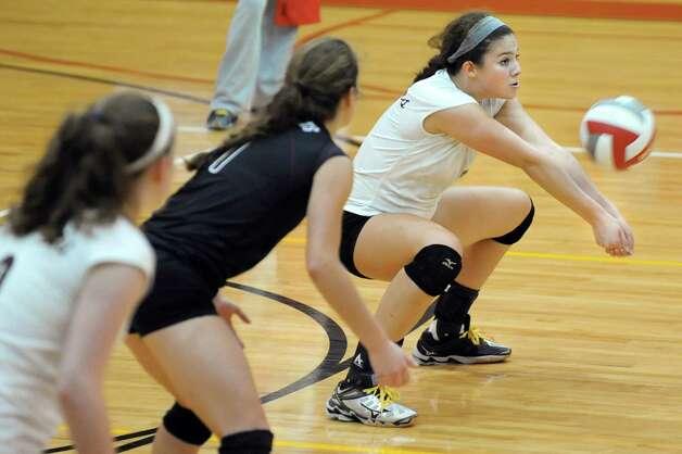 Burnt Hills' Natalie Schurman, right, bumps the ball during their volleyball game against Niskayuna on Thursday, Oct. 16, 2014, at Niskayuna High in Niskayuna, N.Y. (Cindy Schultz / Times Union) Photo: Cindy Schultz / 10028988A