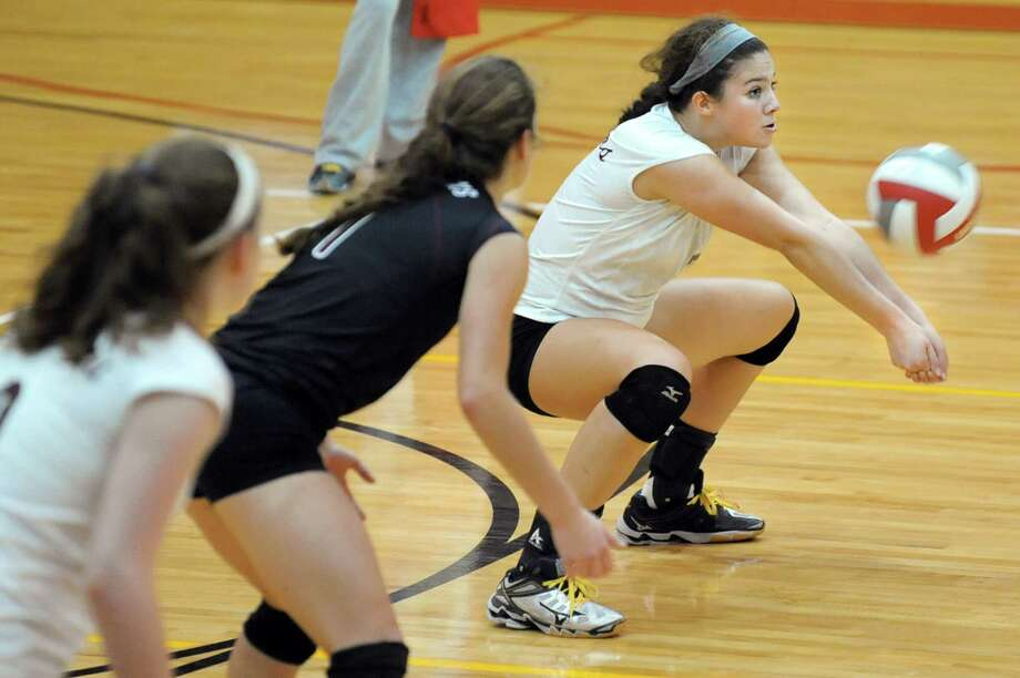 Burnt Hills' Natalie Schurman, right, bumps the ball during their volleyball game against Niskayuna on Thursday, Oct. 16, 2014, at Niskayuna High in Niskayuna, N.Y. (Cindy Schultz / Times Union) Photo: Cindy Schultz / 10028988A