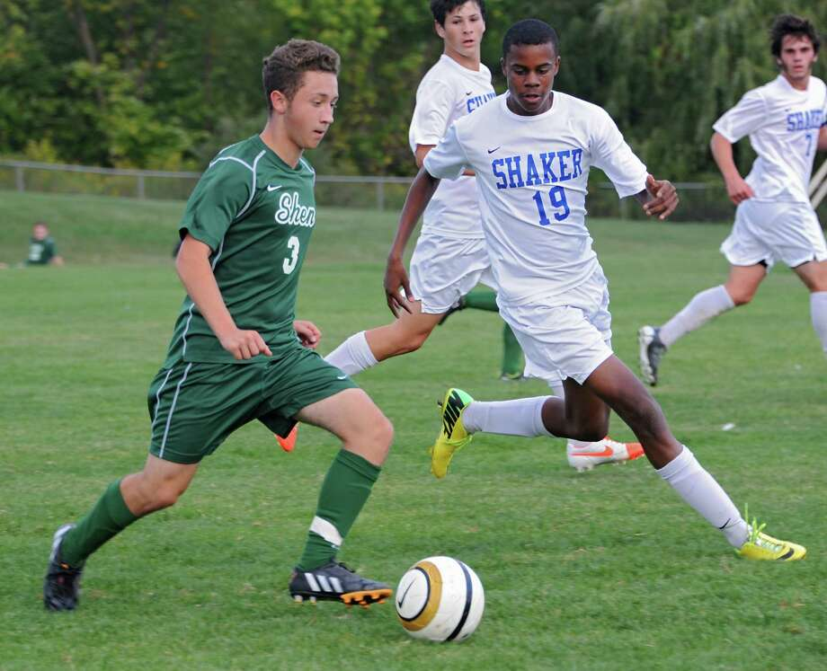 Shenendehowa's Michael Miner runs with the ball followed closely by Shaker's Matt JeanPierre during a soccer game on Tuesday, Sept. 23, 2014 in Latham, N.Y. (Lori Van Buren / Times Union) Photo: Lori Van Buren / 00028697A