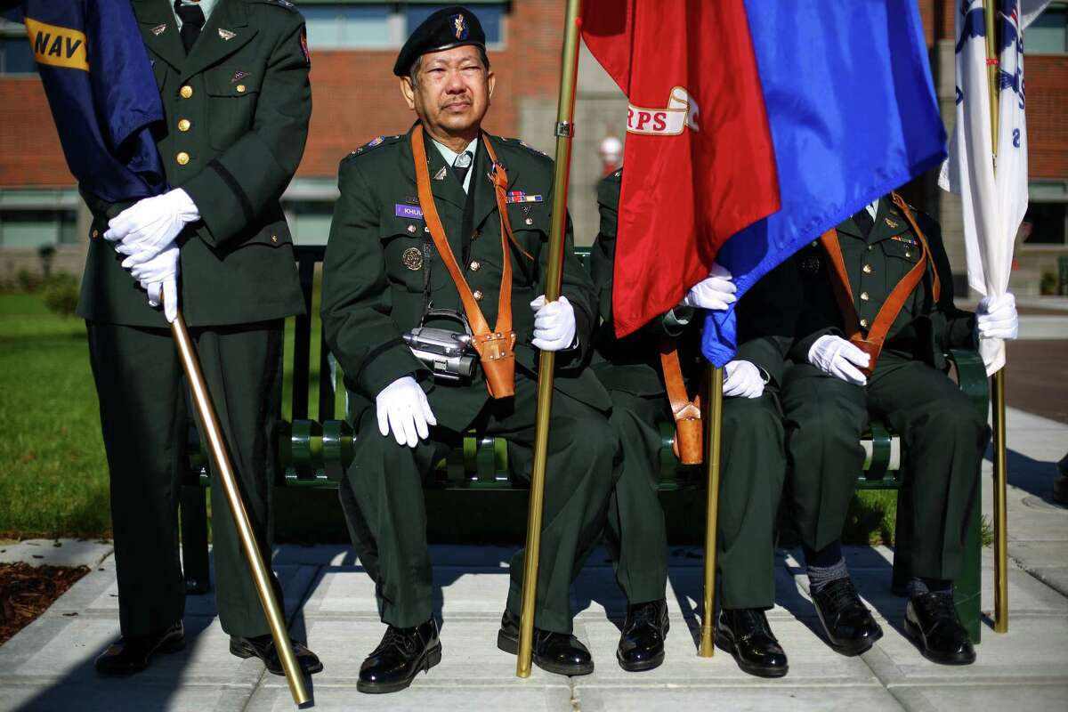 Van Khuu of the United States Volunteers Honor Guard rests before marching in the 49th annual Auburn Veterans Day Parade.