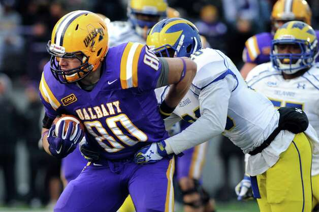 UAlbany's Brian Parker, left, gains yards as Delaware's Donte Raymond defends during their football game on Saturday, Nov. 8, 2014, at Bob Ford Field in Albany, N.Y. (Cindy Schultz / Times Union) Photo: Cindy Schultz / 00029366A