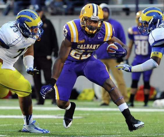 UAlbany's Omar Osbourne, center, shoots the hole during their football game against Delaware on Saturday, Nov. 8, 2014, at Bob Ford Field in Albany, N.Y. (Cindy Schultz / Times Union) Photo: Cindy Schultz / 00029366A