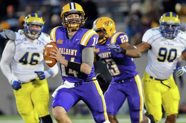 UAlbany's quarterback Will Fiacchi, center, scrambles as he looks for an open man during their football game against Delaware on Saturday, Nov. 8, 2014, at Bob Ford Field in Albany, N.Y. (Cindy Schultz / Times Union) Photo: Cindy Schultz / 00029366A