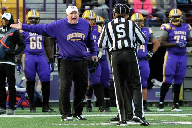 UAlbany's coach Greg Gattuso, center, has words with an official during their football game against Delaware on Saturday, Nov. 8, 2014, at Bob Ford Field in Albany, N.Y. (Cindy Schultz / Times Union) Photo: Cindy Schultz / 00029366A
