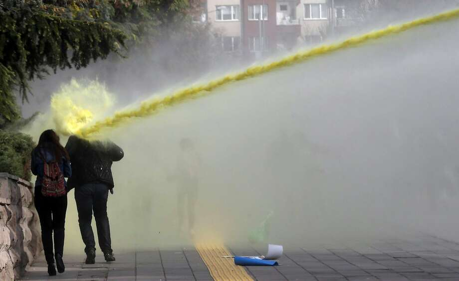 TOPSHOTS Police use water canons on November 8, 2014 to disperse students protesting against the Turkish government and the Higher Education Board (YOK) policies in Ankara.                      AFP PHOTO / ADEM ALTANADEM ALTAN/AFP/Getty Images Photo: Adem Altan, AFP/Getty Images