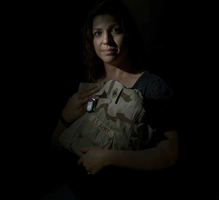 Iraq veteran Evelyn Hlebik is studying to be a teacher. Photo: Billy Calzada / San Antonio Express-News