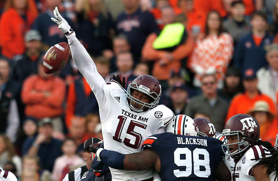 Timely plays helped A&M pull off the the upset, with Myles Garrett, left, setting in motion a turn of events by blocking a field goal attempt that Deshazor Everett returned 65 yards for a touchdown on the final play of the first half.Alonzo Williams, right, clinch-ed the win by   recovering a fumble on Auburn's final possession. Photo: Butch Dill, FRE / FR111446 AP