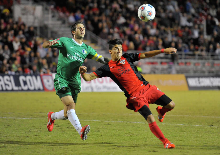 Scorpions Cesar Elizondo eyes the ball as Cosmos Hunter Gorskie moves in during their North American Soccer League playoff game at Toyota Field Saturday. Photo: Robin Jerstad