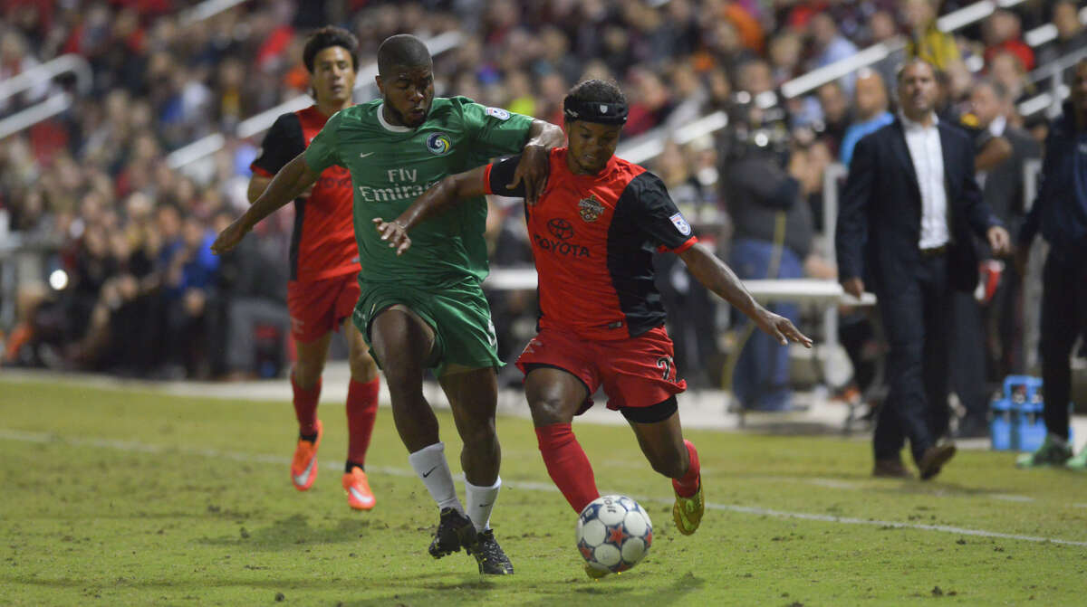 Scorpions Stephen DeRoux battles Cosmos Carlos Medes during their North American Soccer League playoff game at Toyota Field Saturday.