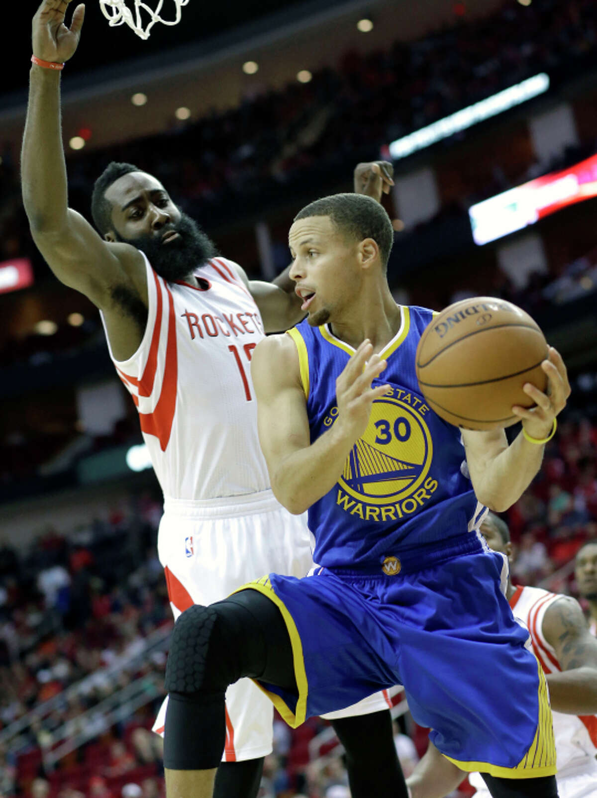 Stephen Curry, who had 34 points, is hounded by James Harden.