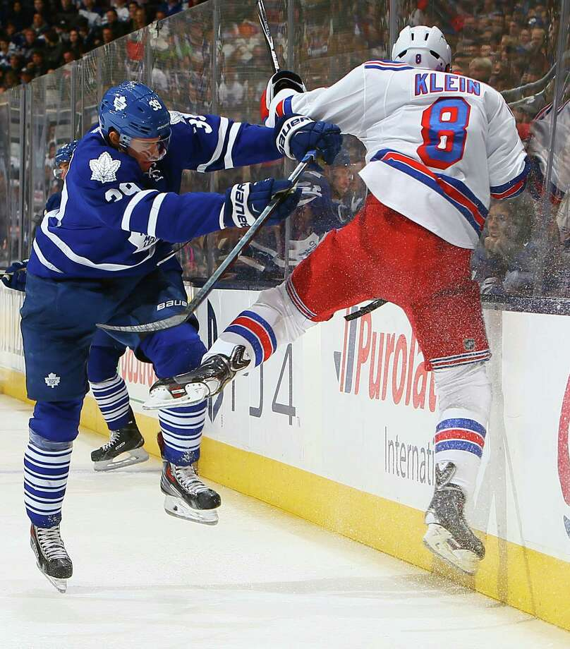 TORONTO, ON - NOVEMBER 8: Matt Frattin #39 of the Toronto Maple Leafs runs into Kevin Klein #8 of the New York Rangers during NHL action at the Air Canada Centre November 8, 2014 in Toronto, Ontario, Canada.  (Photo by Abelimages/Getty Images) ORG XMIT: 507047561 Photo: Abelimages / 2014 Getty Images