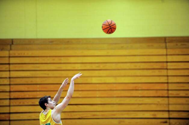 Siena menOs basketball player Rob Poole shoots free throws during practice on Wednesday, March 5, 2014 in Loudonville, NY. (Paul Buckowski / Times Union) Photo: Paul Buckowski / 00026006A