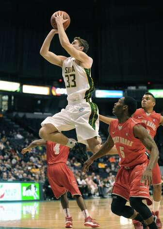 Siena's Rob Poole goes to the basket during their first round College Basketball Invitational game against Stony Brook at the Times Union Center on Tuesday March 18, 2014 in Albany, N.Y. (Michael P. Farrell/Times Union) Photo: Michael P. Farrell / 00026179A