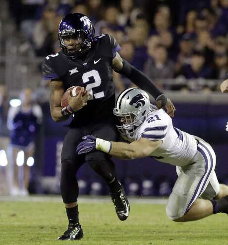 TCU's Trevone Boykin, trying to elude Kansas State's Jonathan Truman, did most of his damage on the ground. Photo: LM Otero, STF / AP