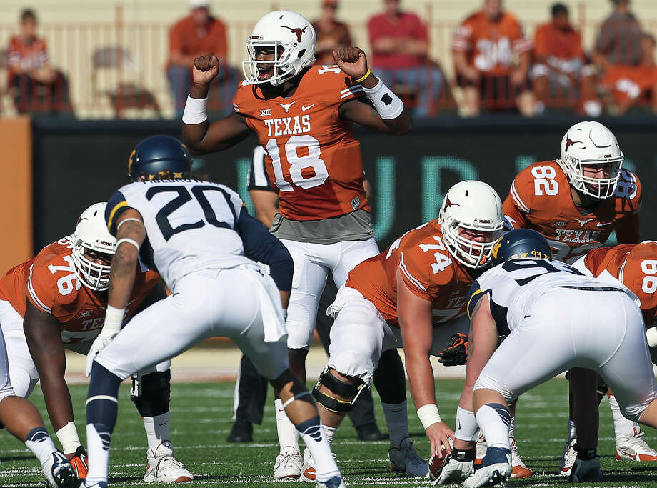 Tyrone Swoops directs the Longhorn offense as Texas hosts West Virgina at Royal Memorial STadium  on November 8, 2014. Photo: TOM REEL, By Tom Reel, San Antonio Express-News