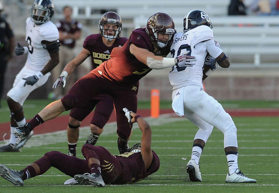 Texas State linebacker David Mayo tackles Georgia Southern receiver Kentrellis Showers (80) during college football action in San Marcos on Saturday, Nov. 8, 2014. Photo: Billy Calzada