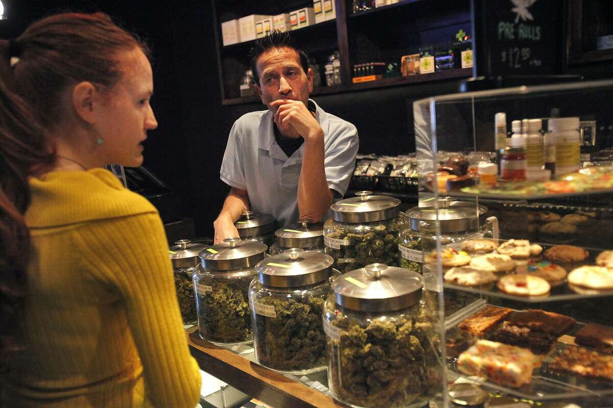 Alexis Jones, 25, a new patient and writer for Medical Jane gets help from bud tender Steve Ryder in the display and dispensary bar area at the medical marijuana dispensary The Green Cross Nov. 6, 2014 in San Francisco, Calif. The Green Cross was founded by Kevin Reed in 2004 and they now see an average of 400 patients a day.