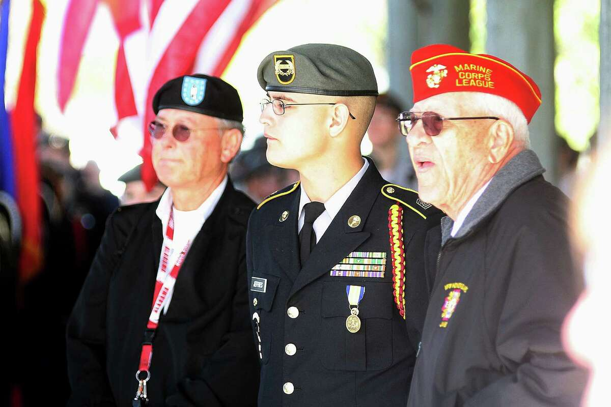 Veterans and active duty service members gather during the Veterans Day ceremony at Dickinson VFW Post 6378.