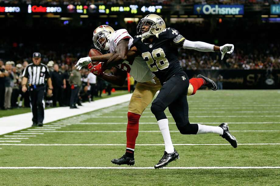 Anquan Boldin catches a touchdown pass in front of Keenan Lewis as the 49ers scored 21 first-half points last Sunday. But the offense has struggled in the second half this season. Photo: Wesley Hitt / Getty Images / 2014 Getty Images