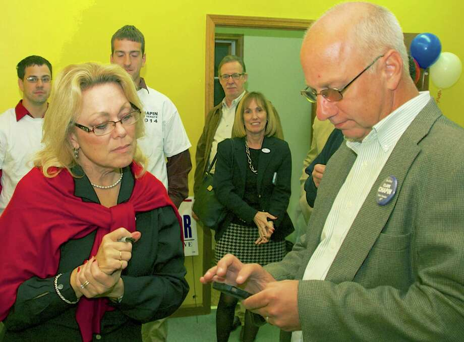 State Sen. Clark Chapin (R-30th) checks the latest update on election night in New Milford as his wife, Mayor Pat Murphy, awaits the vote count at Repbulican headquarters, Nov. 4, 2014 Photo: Trish Haldin / The News-Times Freelance