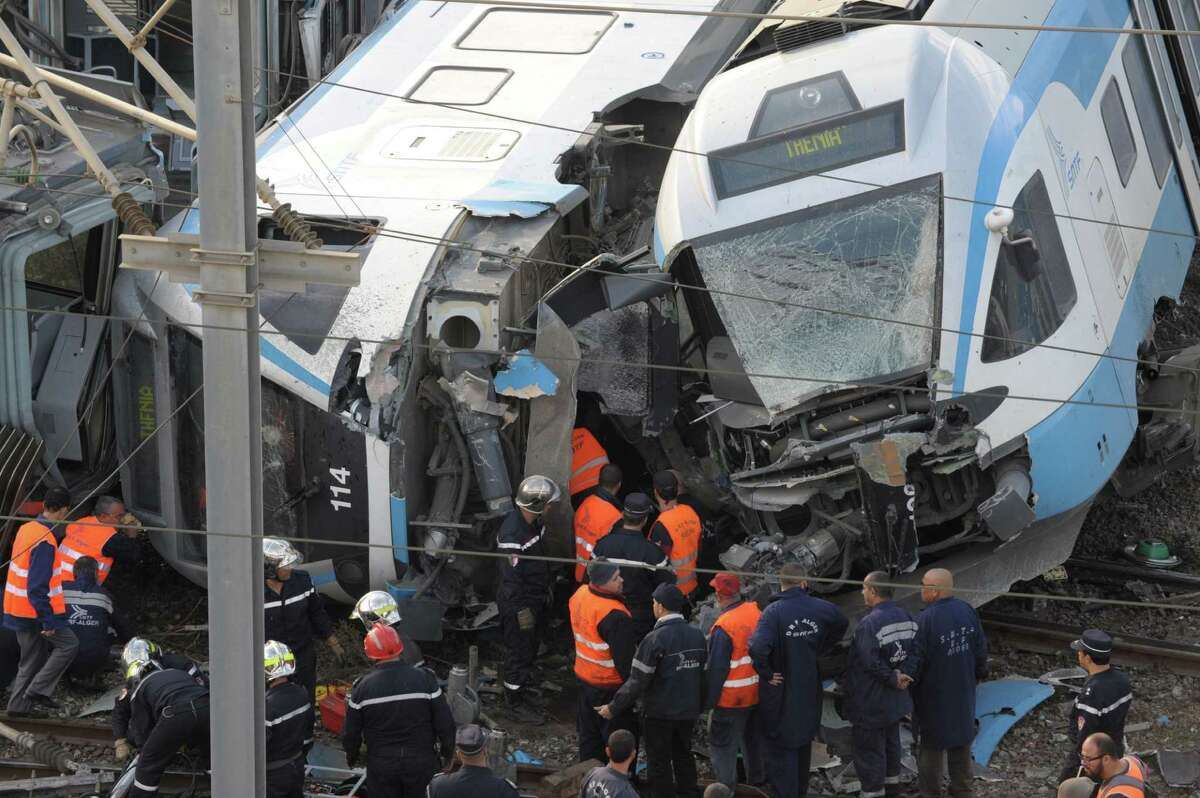 Rescue workers at the scene of a rail crash in Algiers, Algeria, Wednesday, Nov. 5, 2014. Officials say a passenger train has derailed near the downtown Algiers' train station, killing one person and wounding 65, including one in serious condition. The state news agency says the commuter train was moving to another track to make way for the express Algiers-Oran train when its first three cars jumped the rails early Wednesday morning.