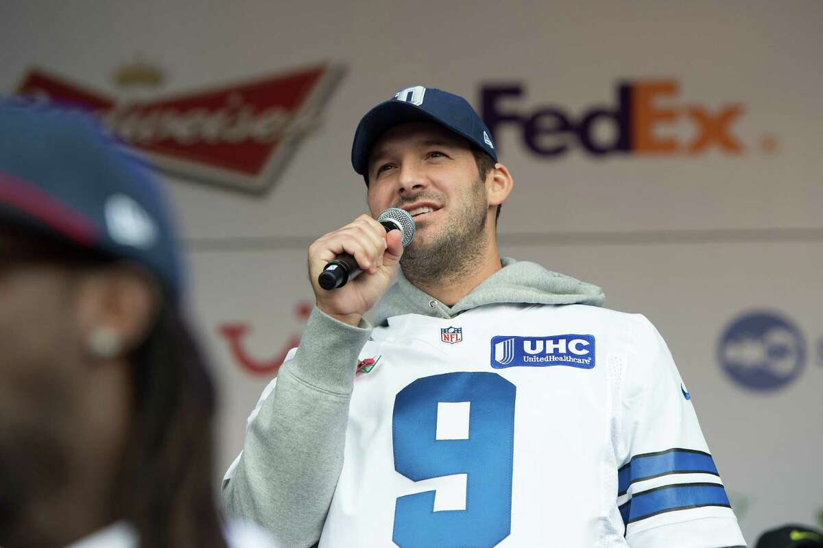 Dallas Cowboys quarterback Tony Romo speaks on stage during the NFL Fan Rally outside Wembley Stadium, London, Saturday, Nov. 8, 2014. The Dallas Cowboys will play the Jacksonville Jaguars in an NFL football game at London's Wembley Stadium on Sunday Nov. 9. (AP Photo/Tim Ireland)