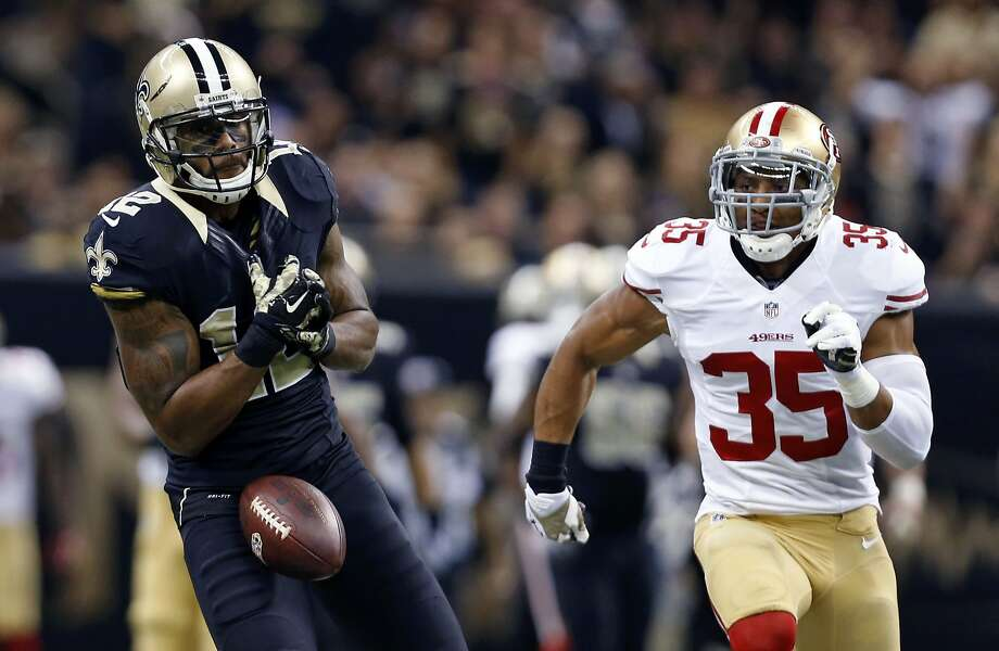 New Orleans Saints wide receiver Marques Colston (12) drops a pass as San Francisco 49ers free safety Eric Reid (35) pursues in the first half of an NFL football game in New Orleans, Sunday, Nov. 9, 2014. (AP Photo/Jonathan Bachman) Photo: Jonathan Bachman, Associated Press