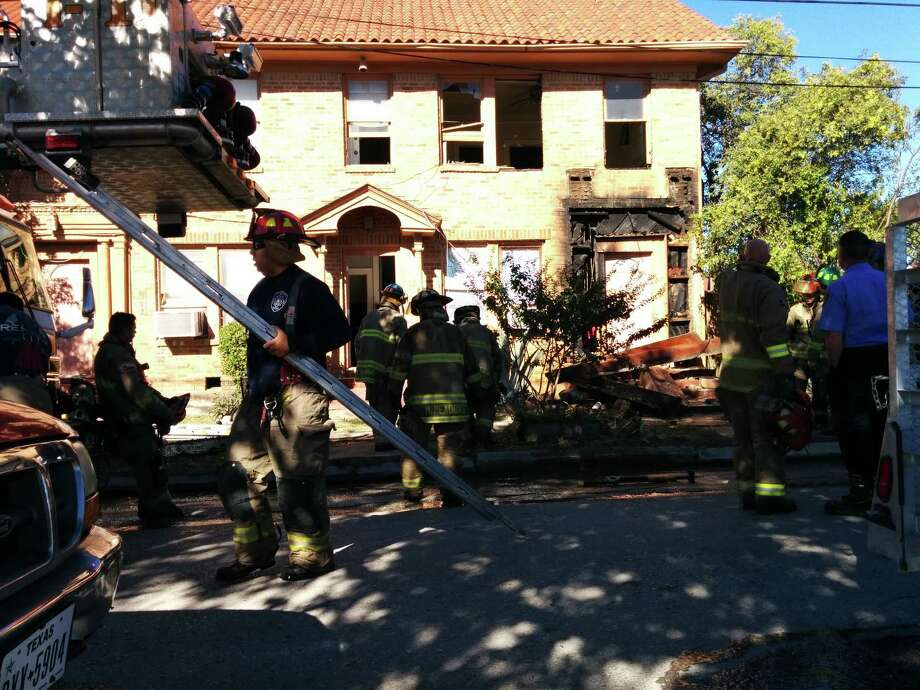 At least 13 units were working the scene in the 100 block of West Carson. Photo: By Jacob Beltran, Express-News