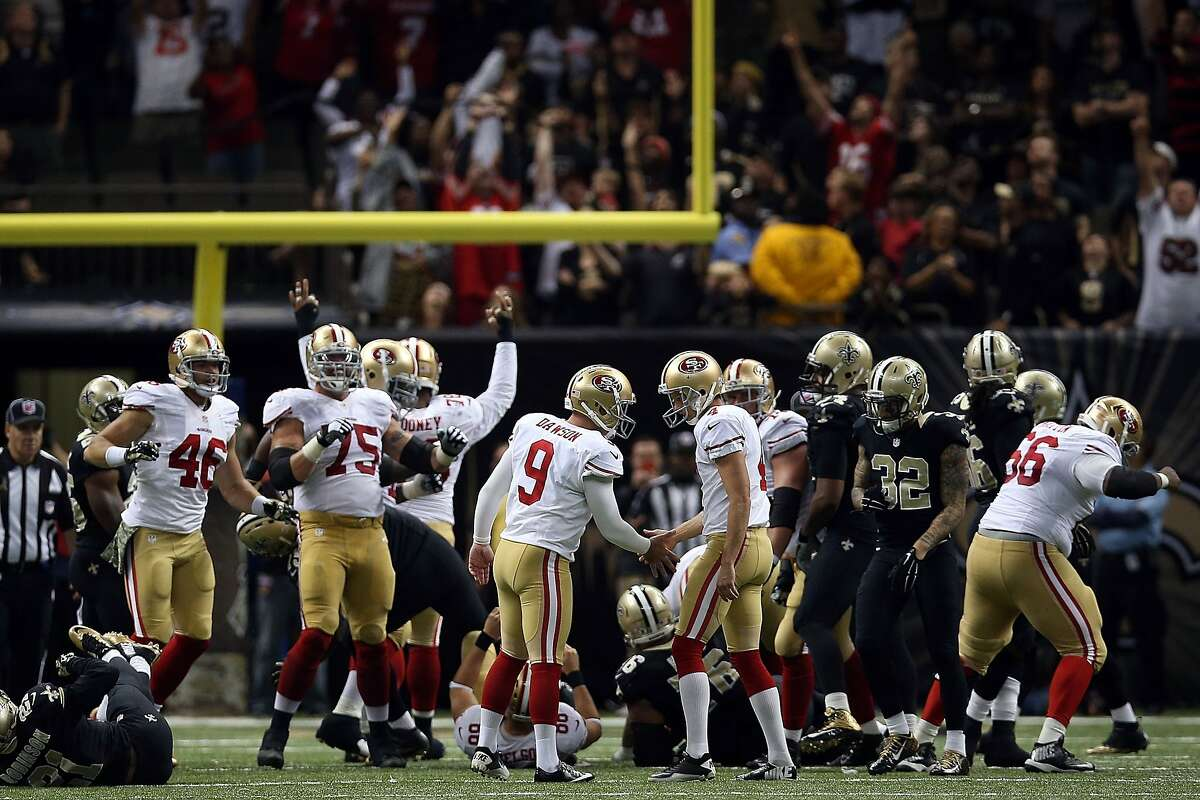 Phil Dawson congratulates teammates following a game winning field goal in overtime against the New Orleans Saints at the Mercedes-Benz Superdome on November 9.