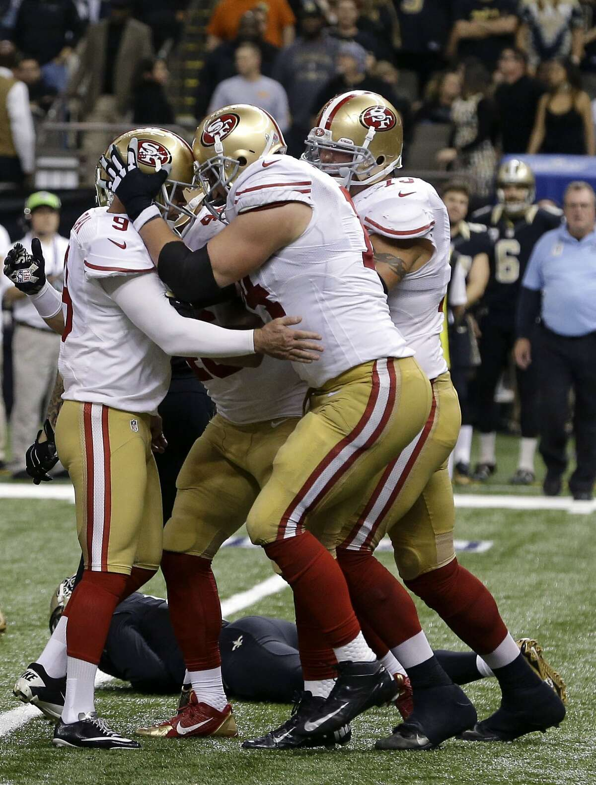 San Francisco 49ers kicker Phil Dawson (9) is congratulated by tackle Joe Staley (74) after kicking the game-winning field goal in overtime.