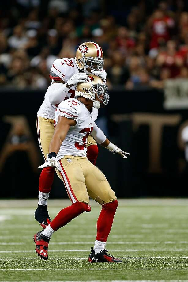 NEW ORLEANS, LA - NOVEMBER 09:  Eric Reid #35 of the San Francisco 49ers is conratulated by Chris Culliver #29 following a defensive stop during the fourth quarter of a game against the New Orleans Saints at the Mercedes-Benz Superdome on November 9, 2014 in New Orleans, Louisiana.  (Photo by Wesley Hitt/Getty Images) Photo: Wesley Hitt, Getty Images