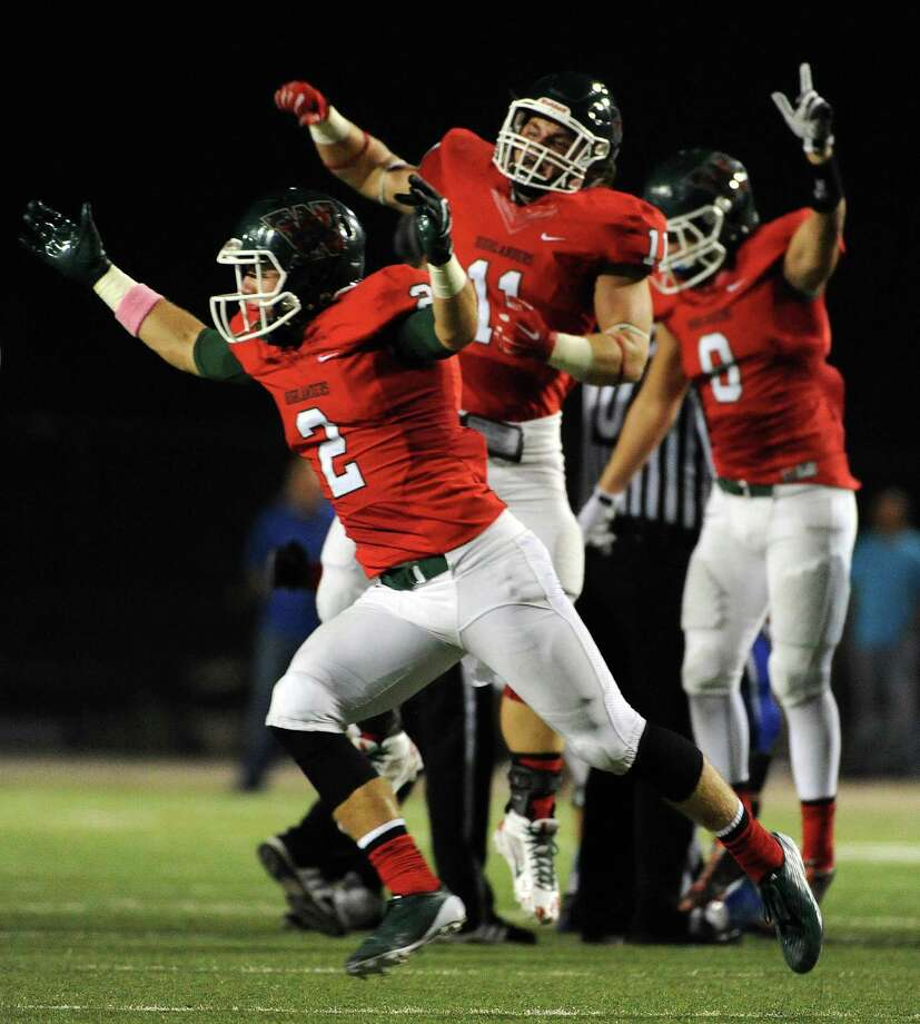 The Woodlands defensive back TC Schneider (2) and teammates celebrate a fumble recovery during the first half of a high school football game against Oak Ridge, Friday, October 24, 2014, at Woodforest Stadium in Shenandoah. (Photo: Eric Christian Smith/For the Chronicle) Photo: Eric Christian Smith, Freelance / 2014 Eric Christian Smith
