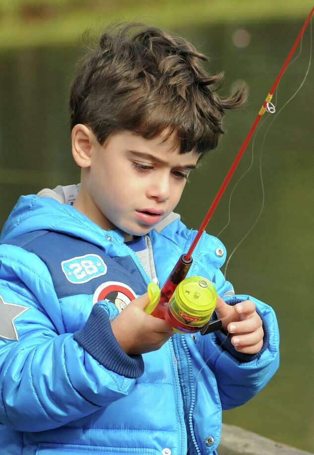 Four year old Duncan Javidi checks his fishing line during the Hook, Line, and Sinker children's fishing class, at Creekwood Park in The Woodlands. The Woodlands Township's Parks and Recreation Rangers showed children, and parents, the safe and correct way to rig and fish during the class. Photo: David Hopper, Freelance / freelance