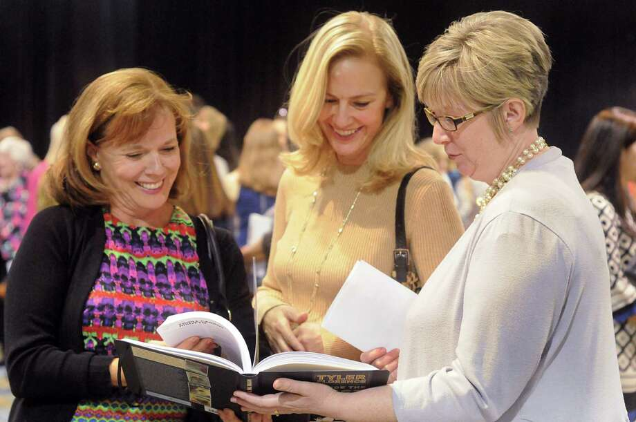 Patty Black, Christi Wetzel, and Kathryn Driskill, all of The Woodlands, examine a cook book Driskill purchased during the John Cooper School Signatures Author Series, featuring author and TV host Tyler Florence, at The Woodlands Waterway Marriott. Area authors also signed their books and visited with guests. Photo: David Hopper, Freelance / freelance