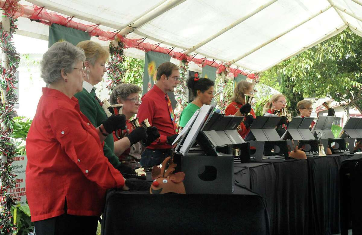 Members of the Heavenly Sounds Handbell Choir perform during the 33rd annual Home for the Holidays in Old Town Spring. Events are scheduled for each weekend through Dec. 24.