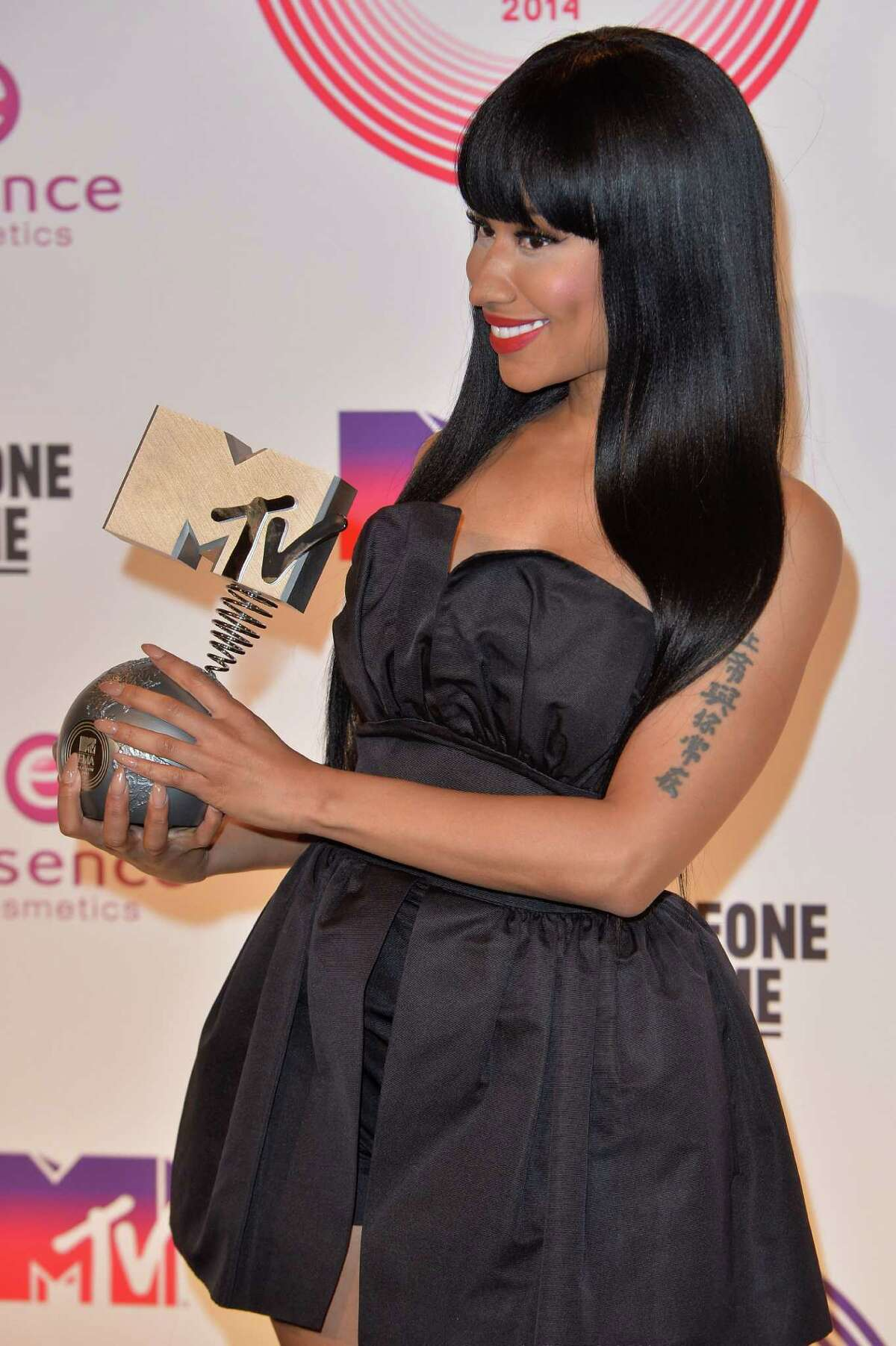 Nicki Minaj is both host and nominee as Scotland lends a tartan touch to the MTV Europe Music Awards. Here she poses backstage with her Best Hip Hop trophy during the MTV EMA's 2014 at The Hydro on November 9, 2014 in Glasgow, Scotland.